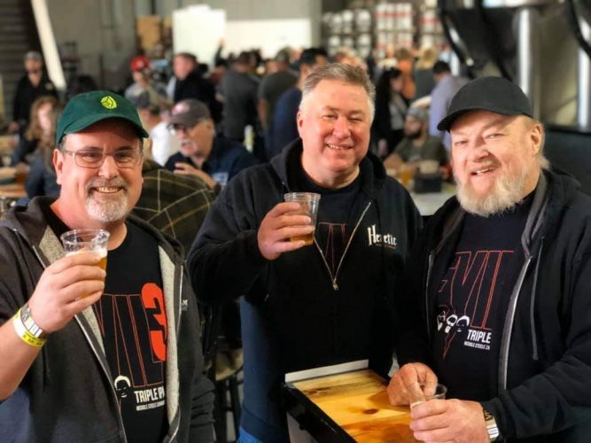 Owner Jamil with two other guys celebrating the evil 3 beer release